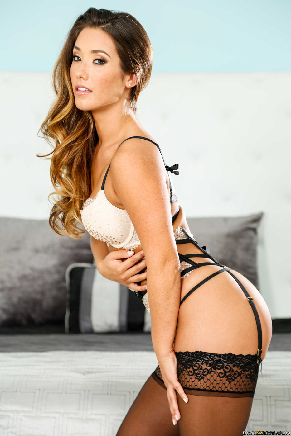 Stunning brunette Eva Lovia plays with her hot tanned boobies  1589934