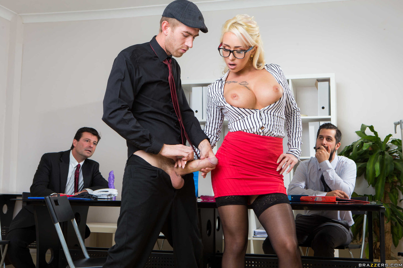 Glasses-wearing MILF boss gets horny during a boring meeting