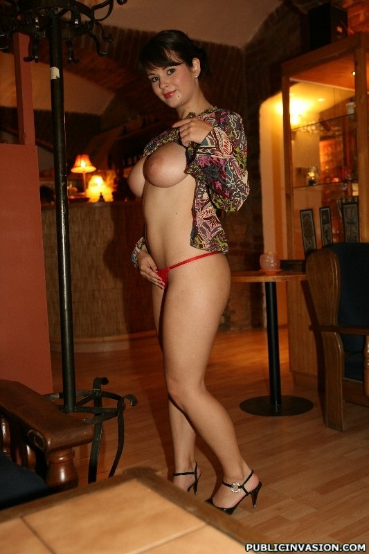 Red panties MILF walking around the parlor and fingering herself