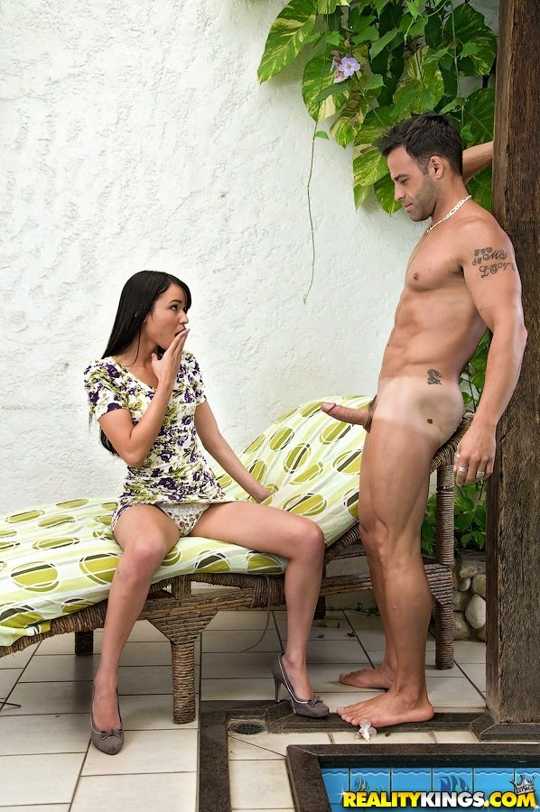 Flat-chested Latina in a dress fucking a big-dicked stud on a recliner